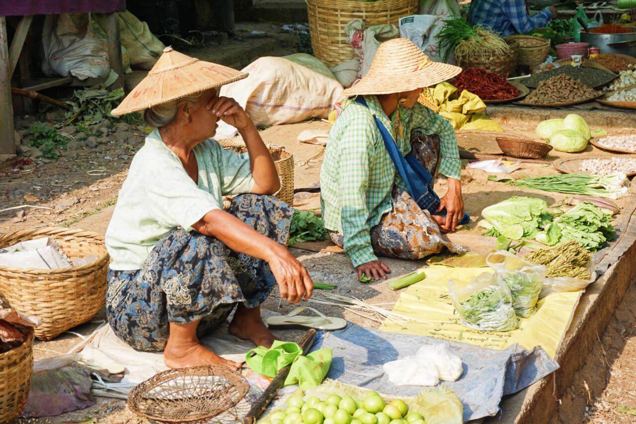 Myanmar photos woman selling food in Burma