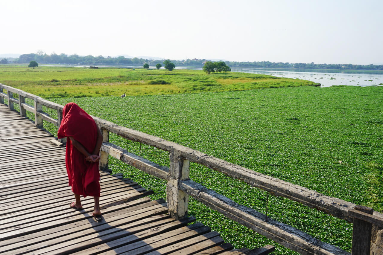 Myanmar photos the long teak bridge in Mandalay with a monk walking it
