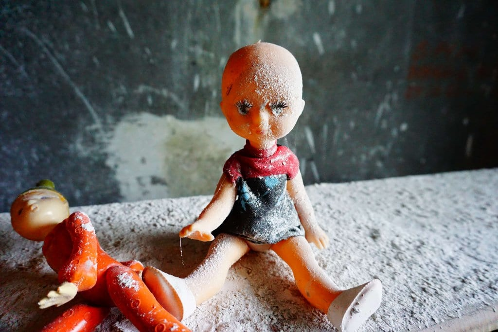 Chernobyl Today: doll covered in dust in Pripyat