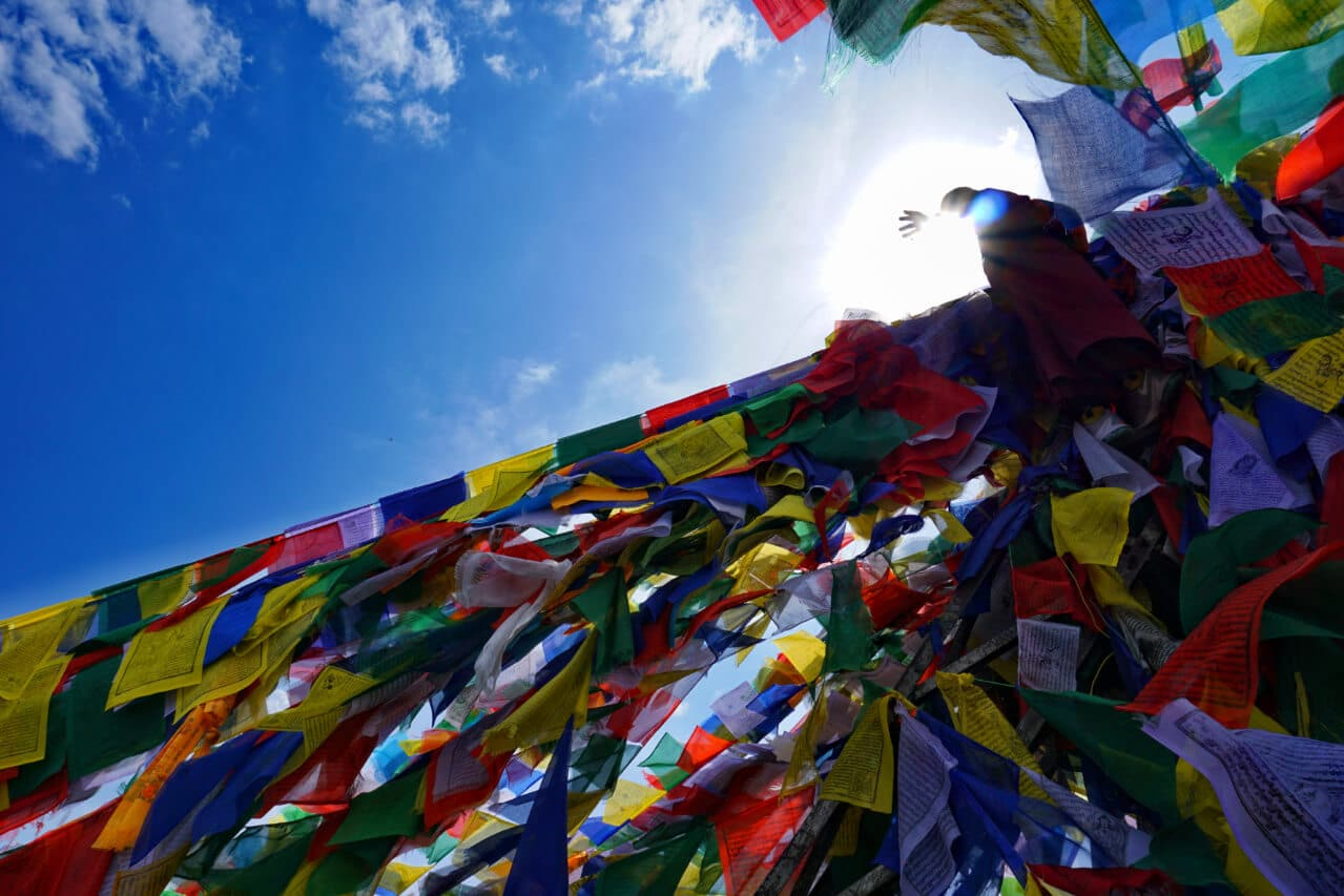 A monk putting up prayer flags in Nepal