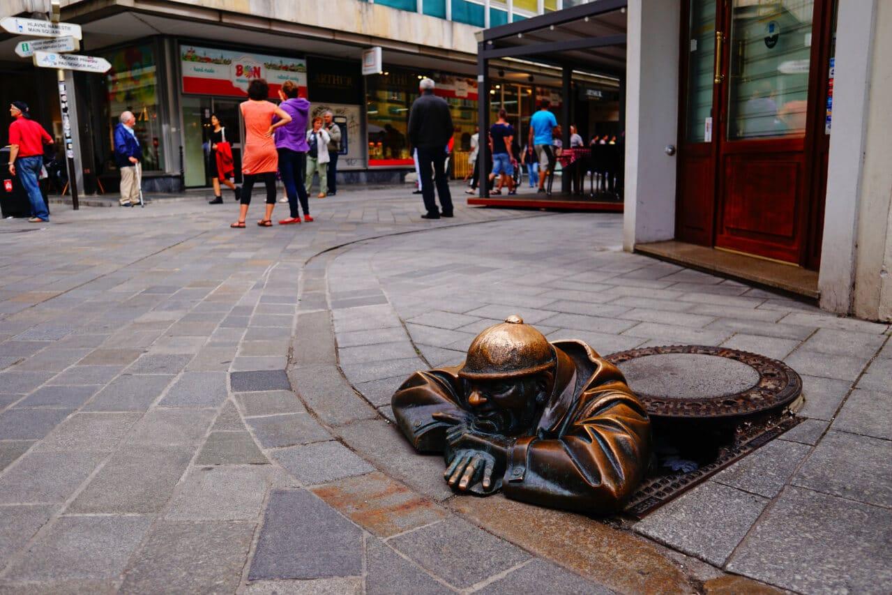 Statue of man in sewer in Bratislava