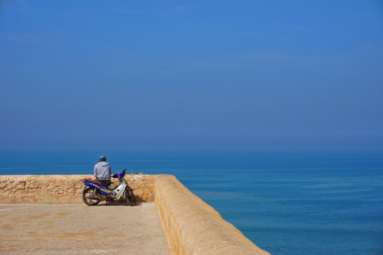 A biker looking over the sea in Rabat
