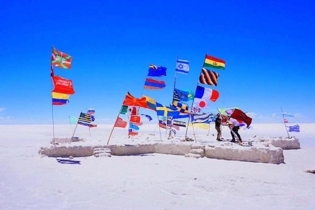 Flags on Bolivian salt flats
