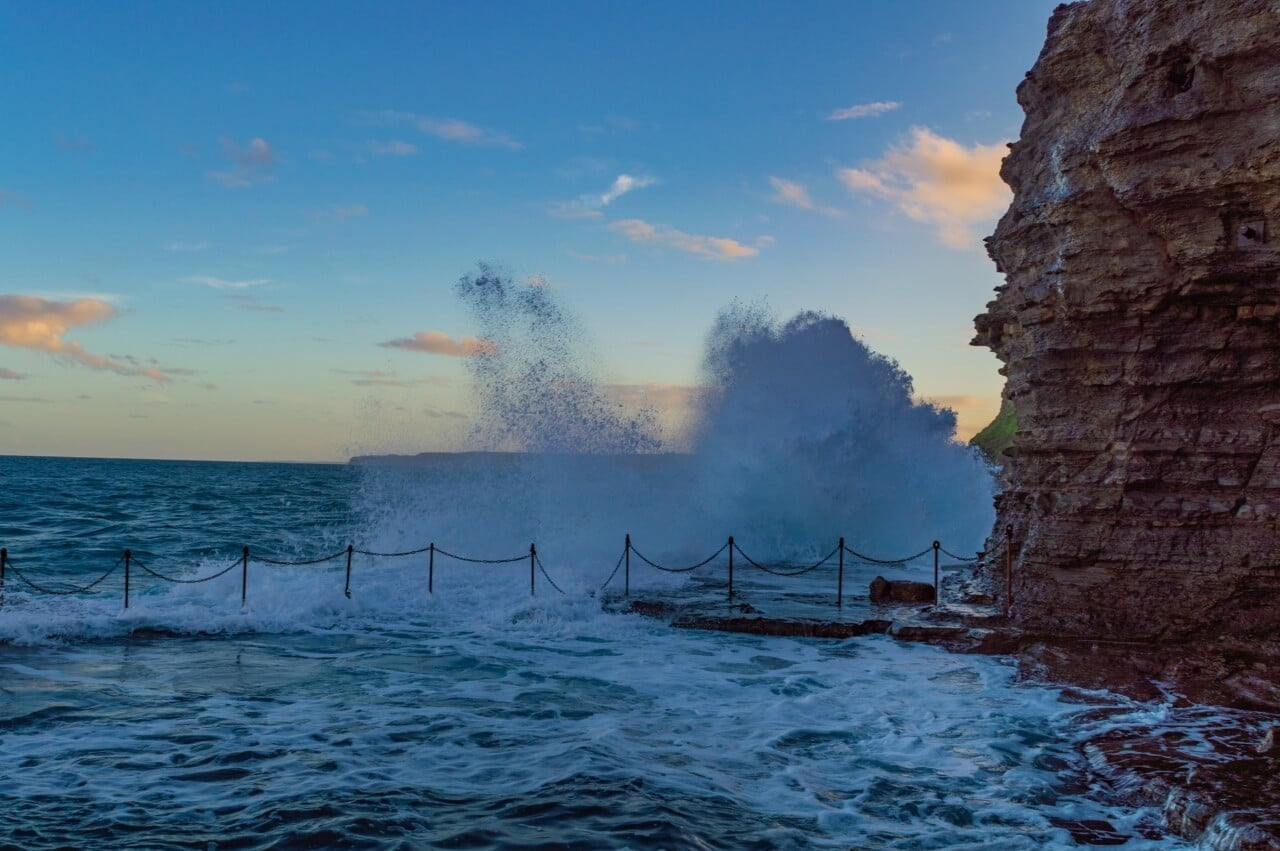 Rough surf can be dangerous at the Bogey Hole, but it is still a top thing to do in Newcastle, Australia