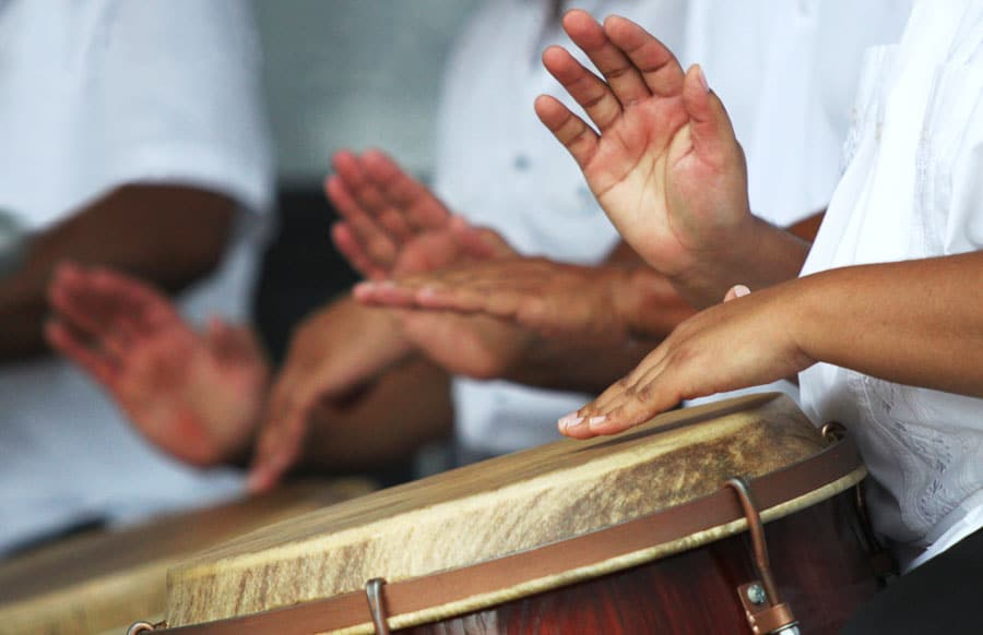 Close up view of people playing drums