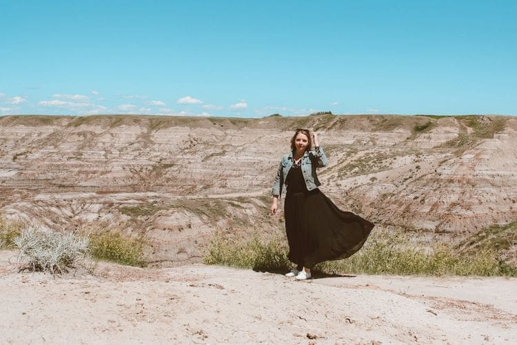 Taylor standing in front of Horsethief Canyon in the Alberta Badlands
