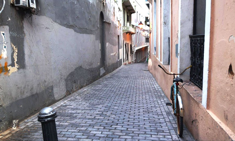 View of a bike in an alleyway