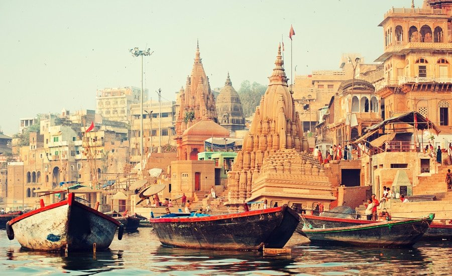 View of boats sailing on the water during Ancient time in Varanasi City