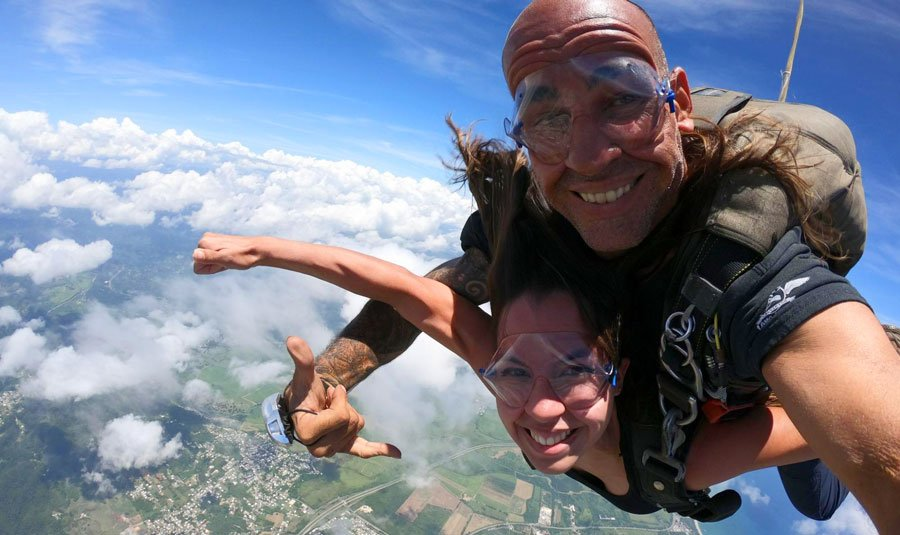 View of the author and a man enjoying their skydiving experience