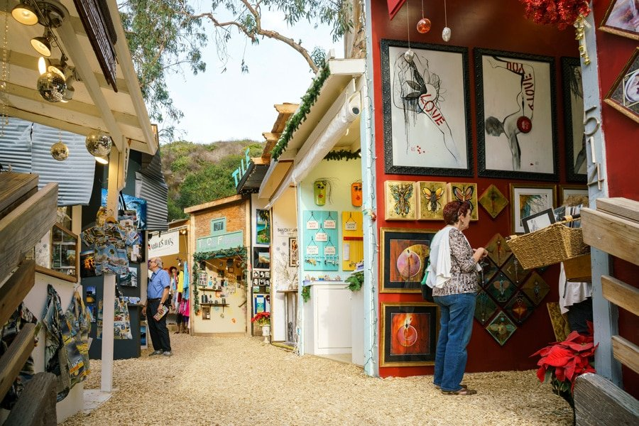 View of a lady and a man looking at the art pieces in Art Festival at the Laguna Beach