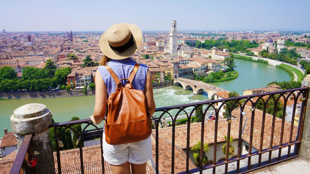 View of a traveler admiring the Verona City in Italy