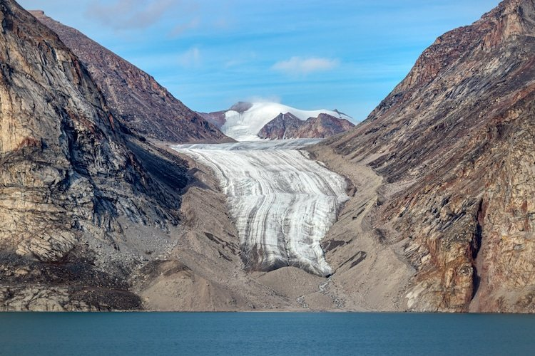 A glacier rests among mountains in Baffin Island, Nunavut Canada