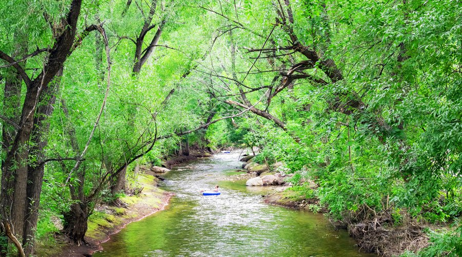 A man in a tube on the Boulder Creek, one of the top things to do in Boulder Colorado