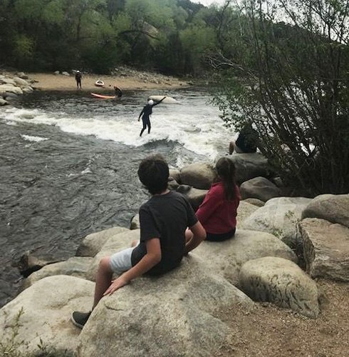 View of people trying river surfing in Arkansas River