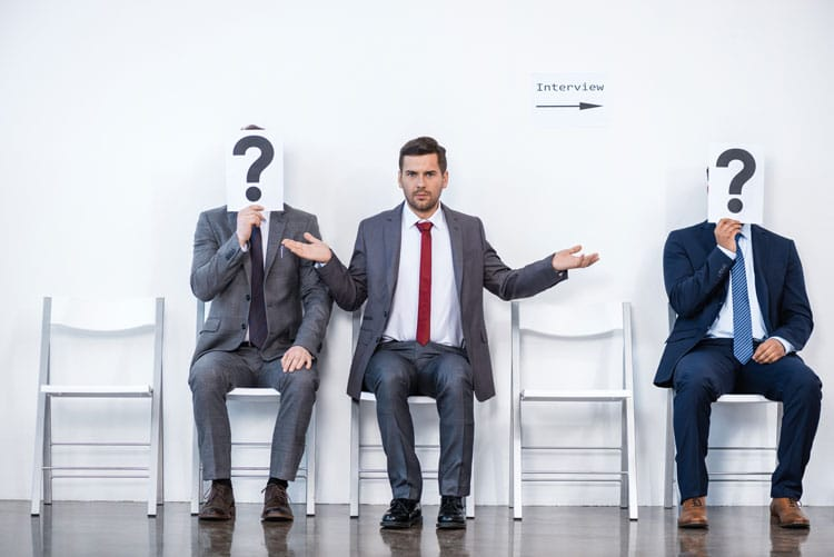Businessmen sitting with question mark sign