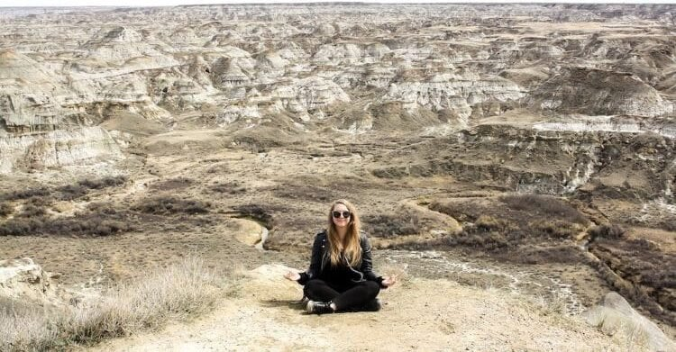 The author sitting in a canyon in Canada