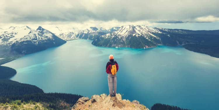 Hiker looking over a lake in the Canadian Rockies