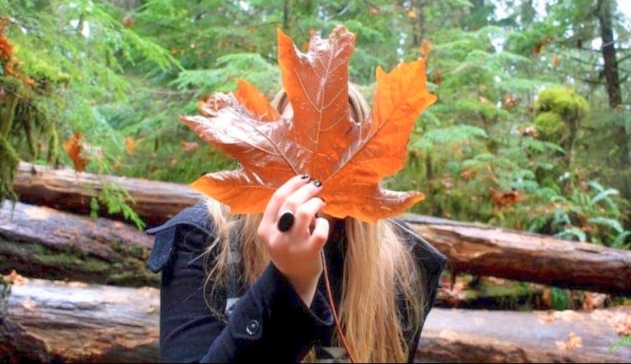 View of the author of the Canada travel tips, holding a Canadian maple leaf