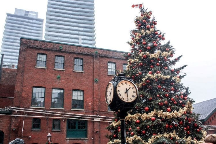 A Christmas tree and old clock in the Distillery District in Toronto, Ontario Canada