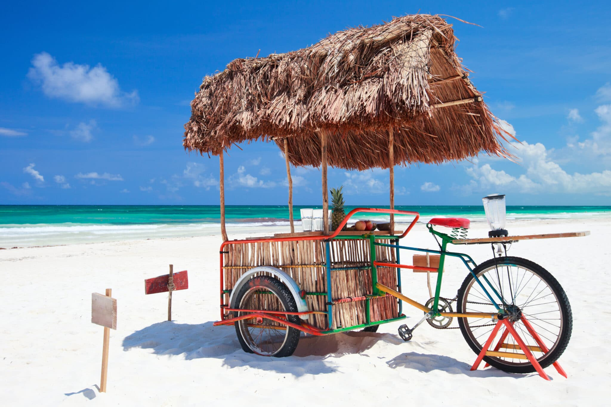 Bike and cart on beach in Tulum Mexico