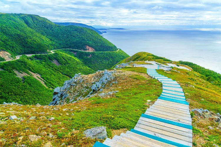 A boardwalk winds down a coastal section of the Cabot Trail in Nova Scotia, Canada