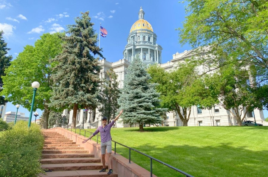 View of the author in front of the Colorado State Capitol Building in Denver