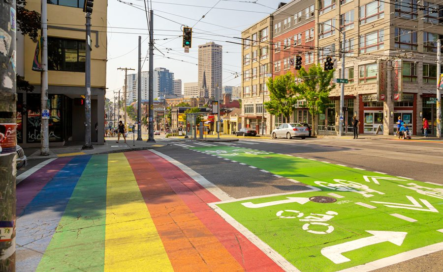 View of pride rainbow crosswalk and a bike lane in Capitol Hill