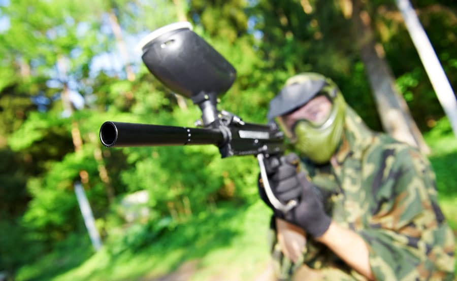 View of an aiming paintball player