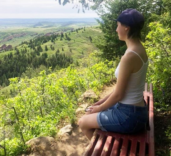 View of the author's daughter enjoying the scenery in Carpenter Peak