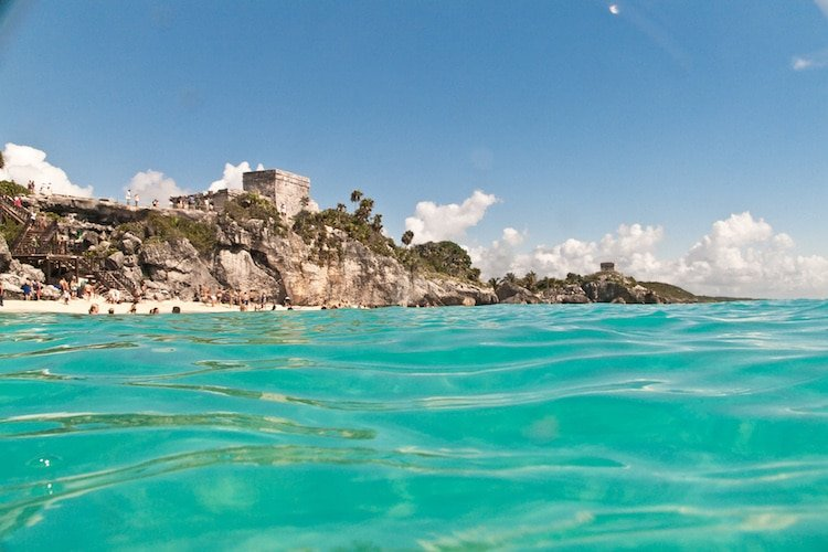 A view of the Tulum Ruins from the middle of the sea in Quintana Roo, Mexico
