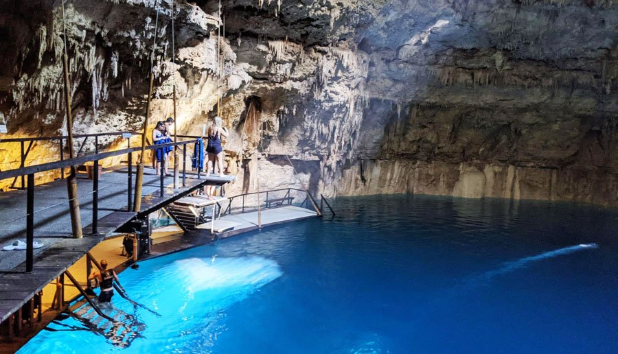 View of people preparing for a swim in Cenote Chukum
