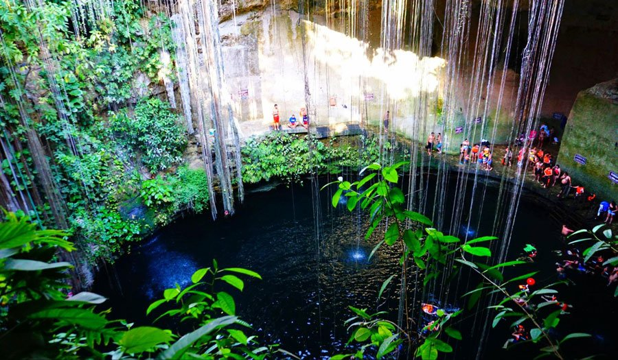 View of tourists in Cenote Ik Kil