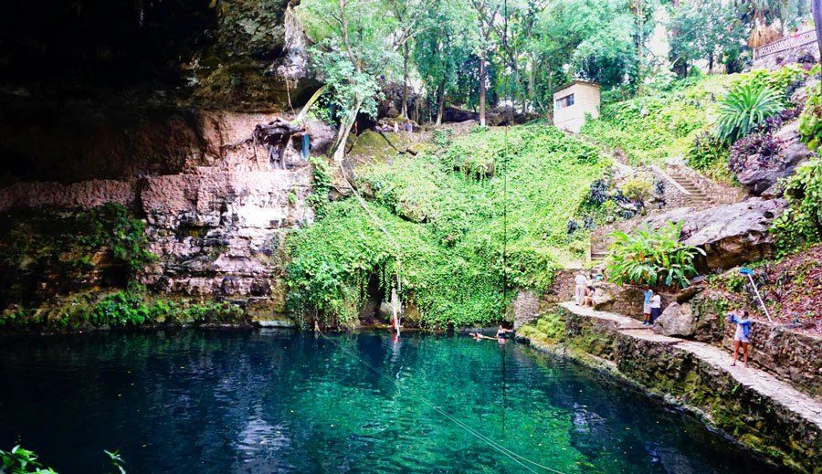 View of the blueish water from Cenote Zaci