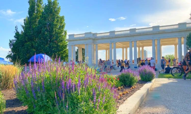 View of wildflowers in front of Greek columns in Cheeseman Park Denver