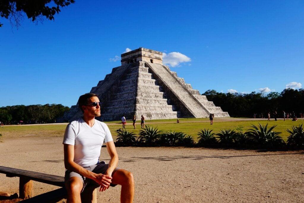 Man sitting at Chichen Itza Mayan ruins