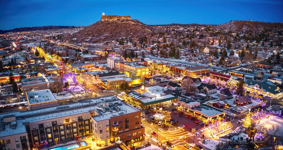 Aerial view of Castle Rock at night during Christmas season