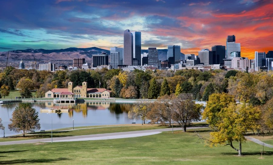 View of Denver skyline in backdrop with City Park in the foreground
