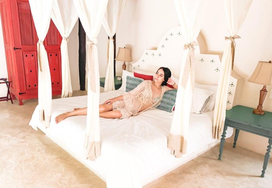 Clara on a bed in the Coco Hacienda hotel in Tulum, Quintana Roo