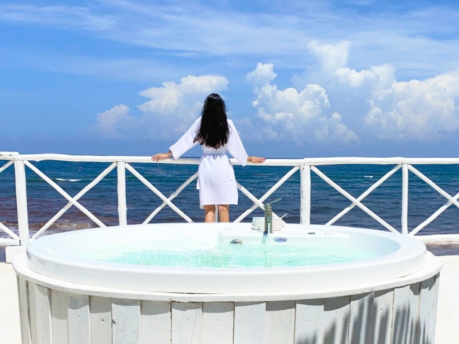 Clara looking at the Caribbean Sea from the Coco Limited Jacuzzi Terrace