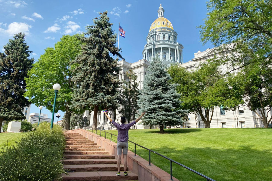 View of TravelLemming's founder in front of the Colorado Capitol in Denver