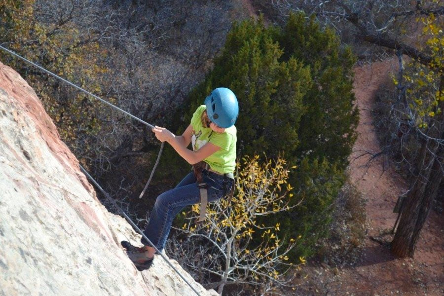 View of girl repelling in Garden of the Gods