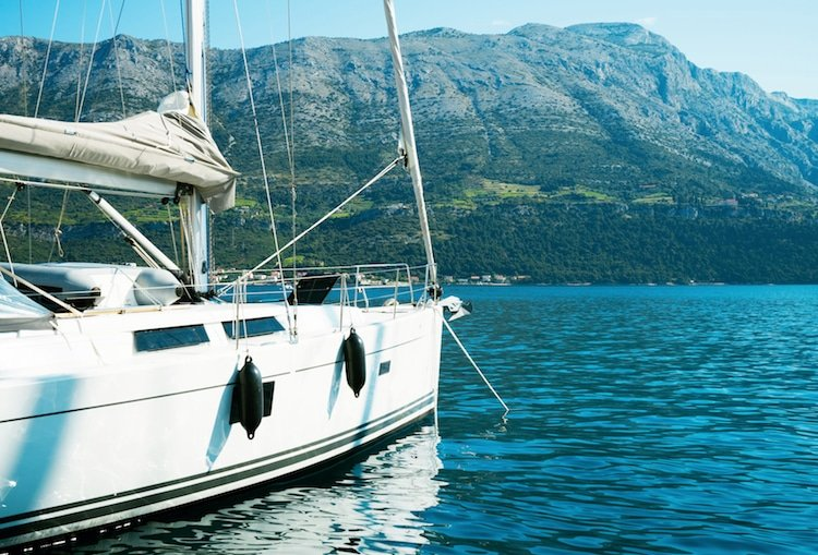 View of a yacht, dock, and mountains in Croatia