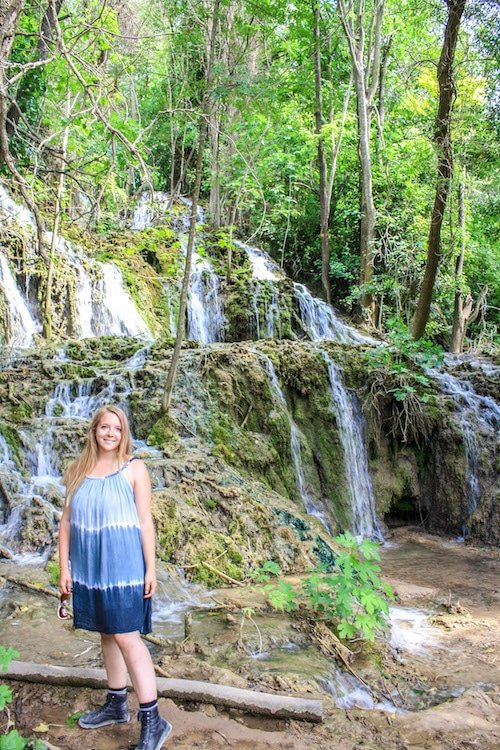 Taylor stands in front of small waterfalls in Krka National Park, Croatia