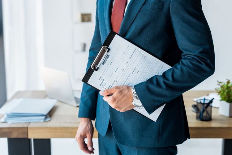 Man holding clipboard with resume