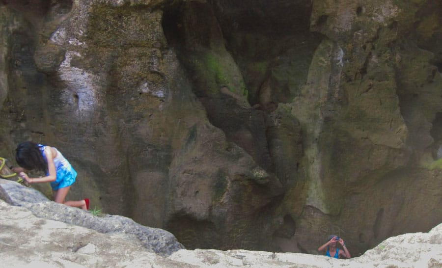 View of a girl going down to Cueva del Indio