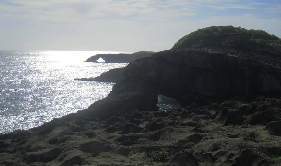 View of rock formation and the calm sea in Cueva del Indio
