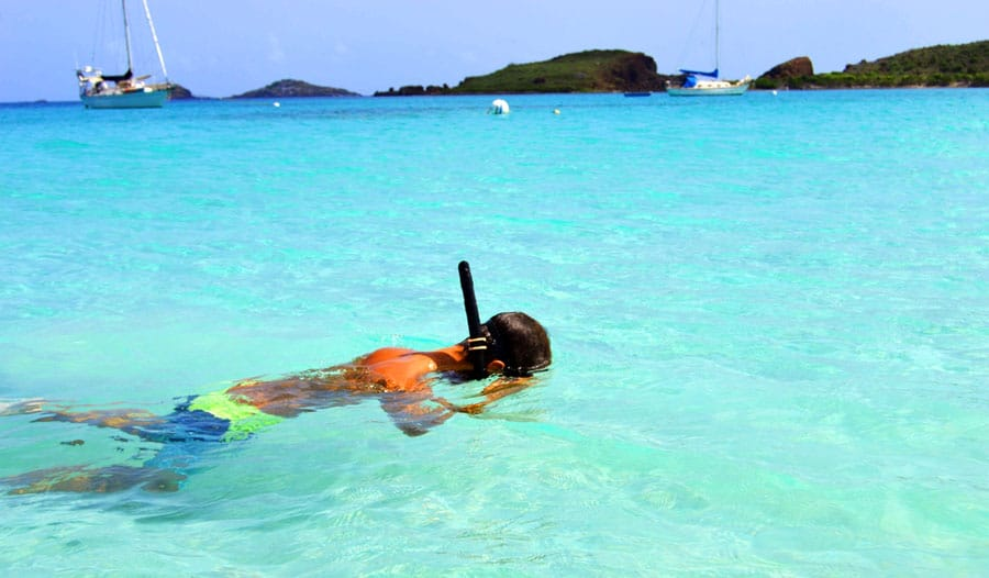 View of a man trying out snorkeling in Culebrita