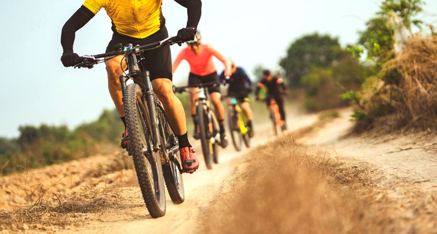 A group of cyclists in a rural area
