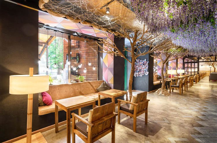 cozy coffee shop interior with wooden tables and chairs and standing lamp
