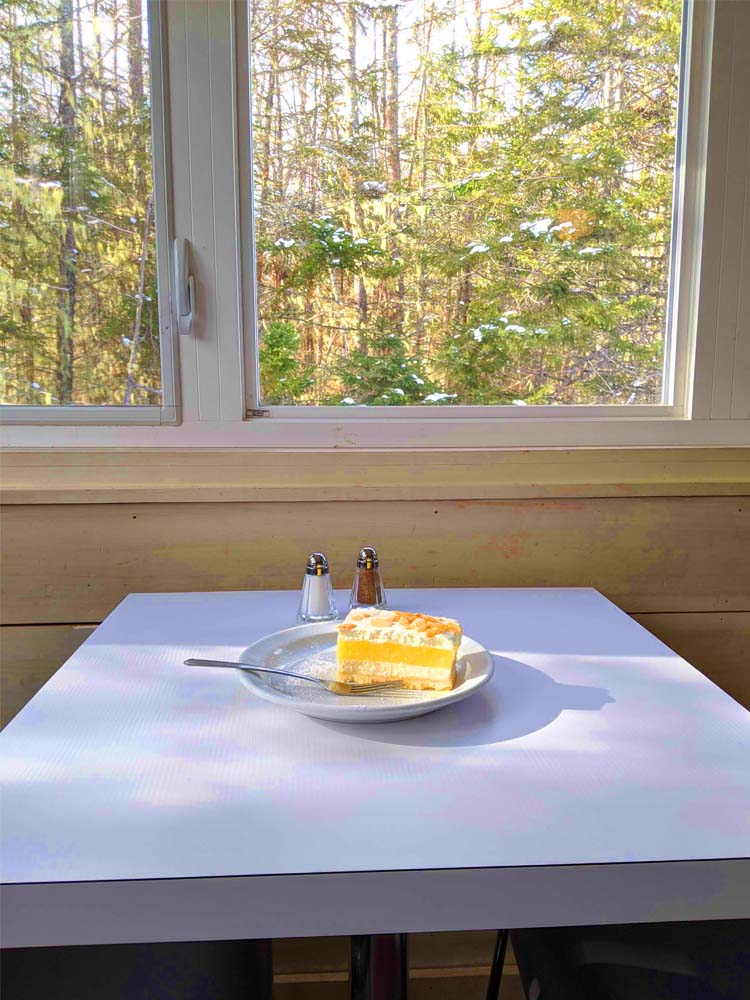 a plate of cake on a table inside Dancing Goat at Cabot Trail